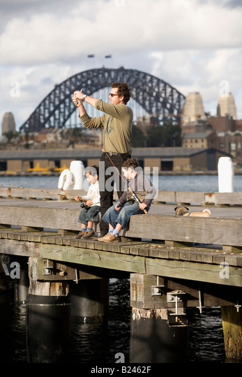 Father and Sons Fishing Pyrmont Point Park Sydney New South Wales Australia Stock Foto
