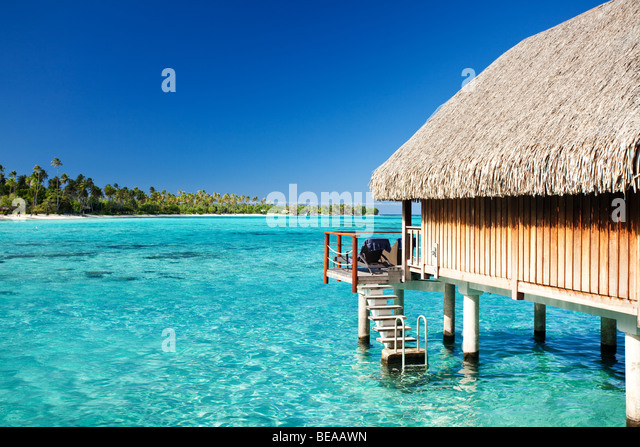 Over water bungalow with steps into amazing lagoon Stock Foto