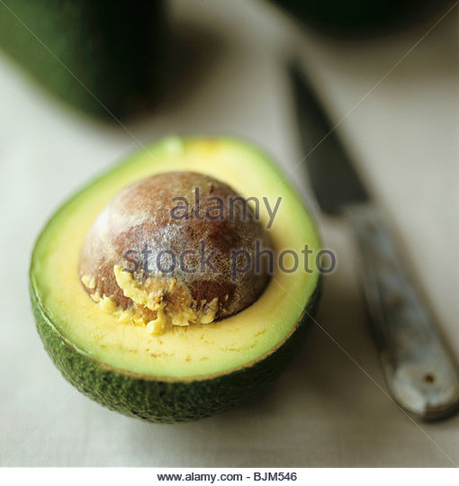 Half an avocado with stone Stock Foto