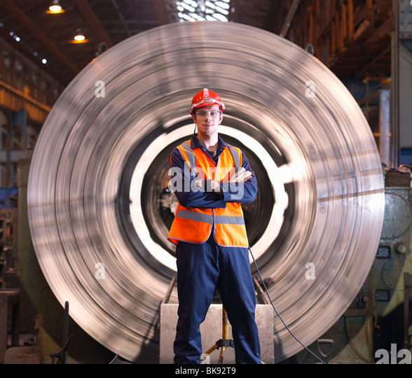 Engineer In Front Of Steel Lathe Stock Foto