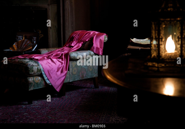 Close up of a red robe inside a bedroom Stock Photo