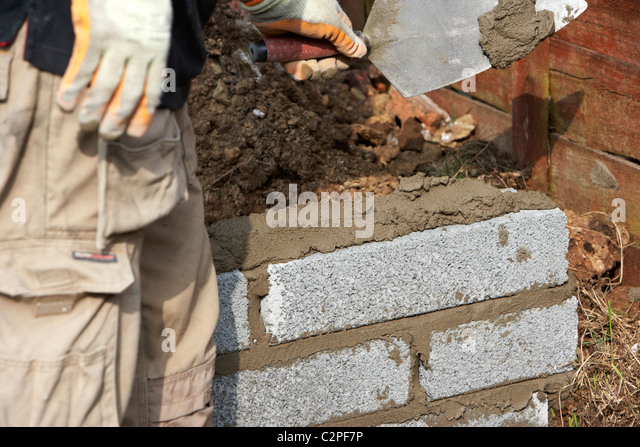 Bricklayer Building A Wall Laying Half Cement Breeze
