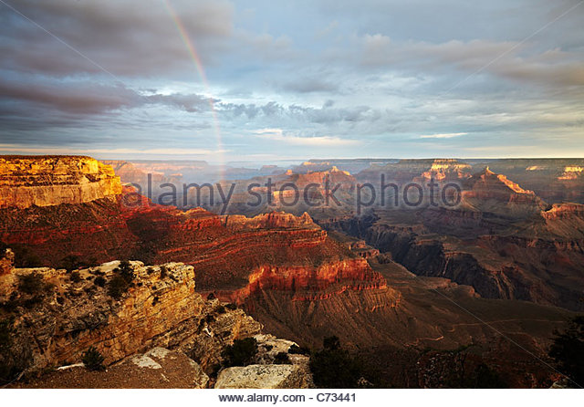 The sunrise, morning light and rainbow across the Grand Canyon, Arizona, USA Stock Foto