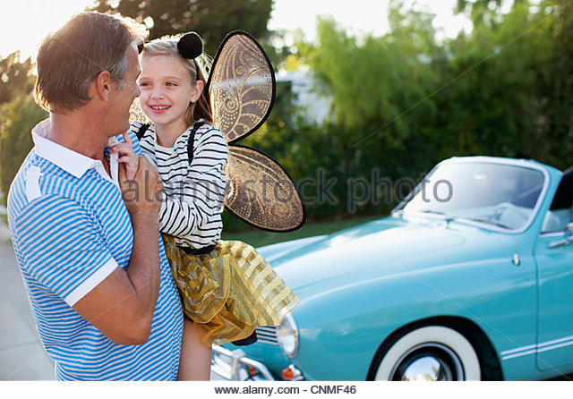 Father holding daughter in fairy wings Stock Foto