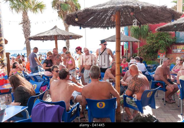 British men drinking at bar on the waterfront, Benidorm, Costa Blanca, Spain Stock Photo