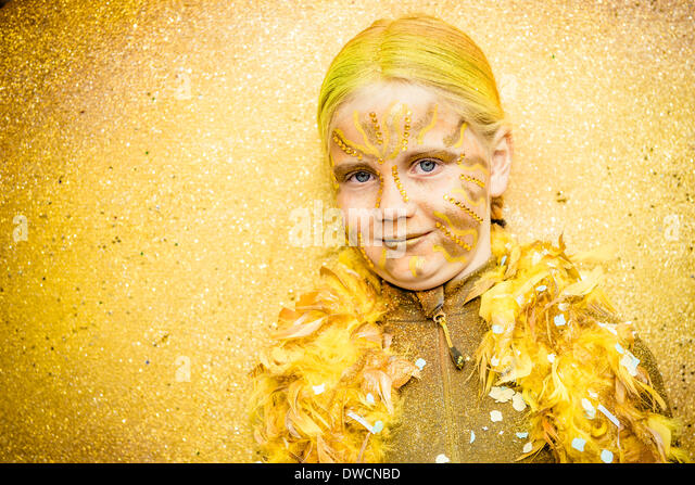 Sitges, Spain. March 4th, 2014: A girl in an fantasy costume dances during the the children carnival parade in Sitges. Stock Foto