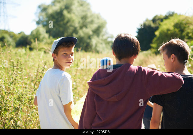 Portrait of boy wearing cap with friends Stock Foto