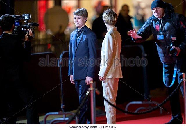 Paris, France. February 26th, 2016. FRANCE, Paris: French actors Rod Paradot (L) and et Diane Rouxel walk on the Stock Photo