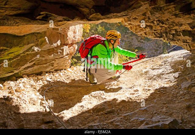 climber-in-a-rock-window-via-ferrata-in-