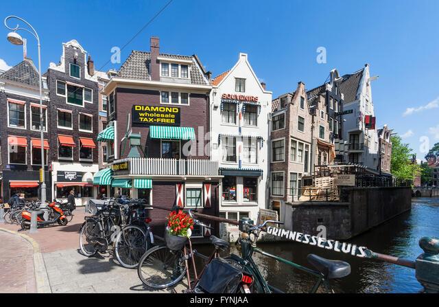 Amsterdam diamont factory , Grimnesssluis, bicycles, tulips,  Amsterdam, Netherlands Stock Photo