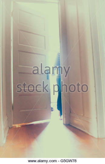 Figure exiting through a door Stock Foto