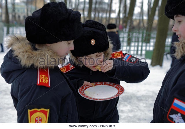 St. Petersburg, Russia, 26th February, 2017. Cadets of Suvorov military school eating blinis during Shrovetide celebrations Stock Photo