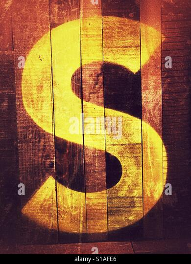 Letter S printed on wall Stock Foto