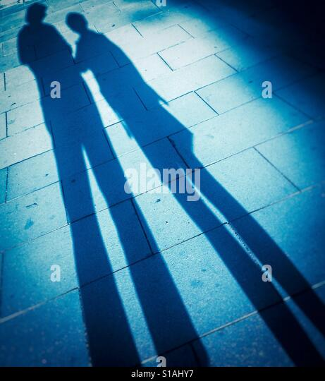 Mother taking care her son. Shadowy portrait Stock Photo